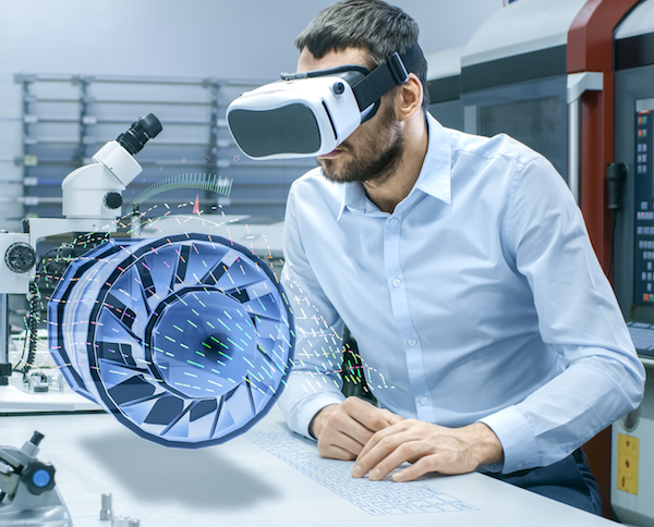 Man studying a virtual jet engine through VR glasses