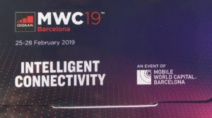 "MWC19 Detail of the attendee badge showing the theme ""Intelligent Connectivity"""