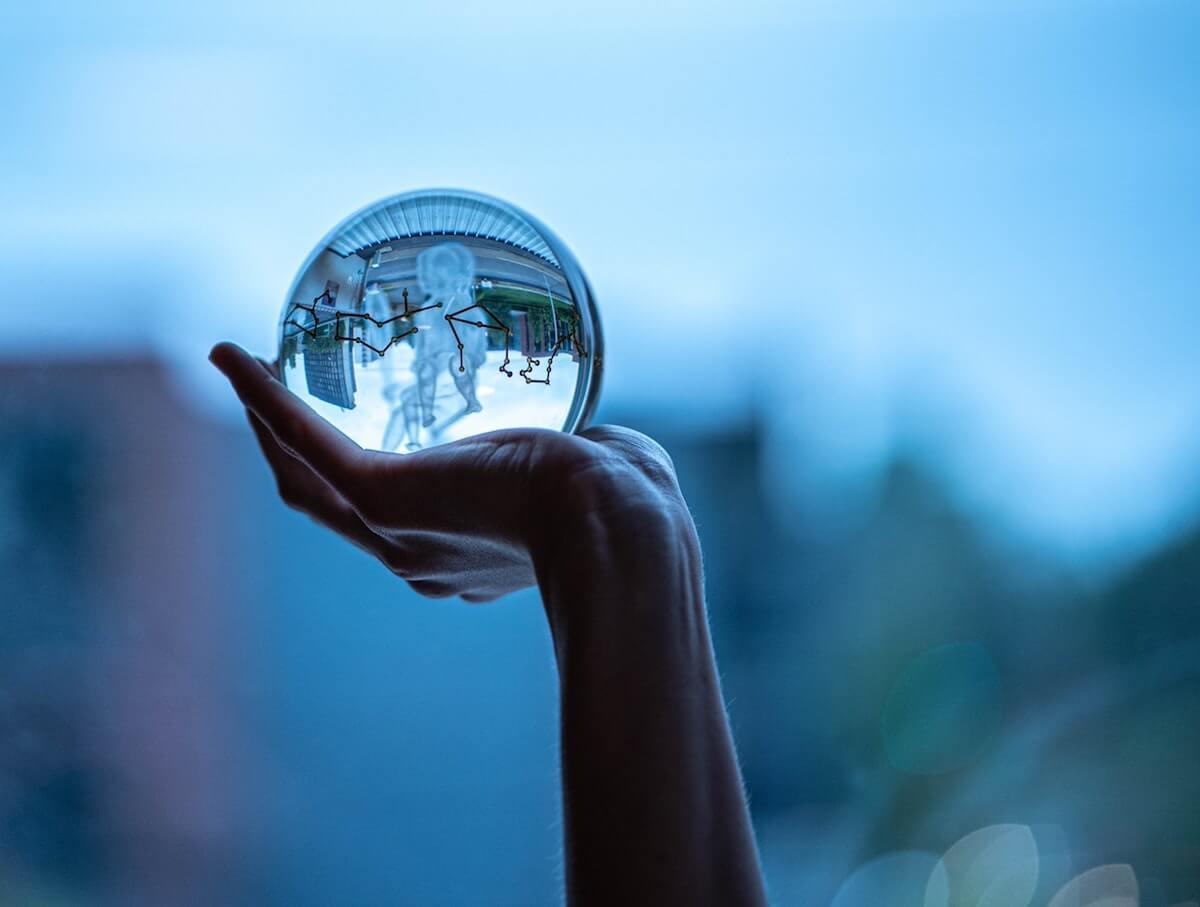 hand-holding-a-glass-ball-2330029 2