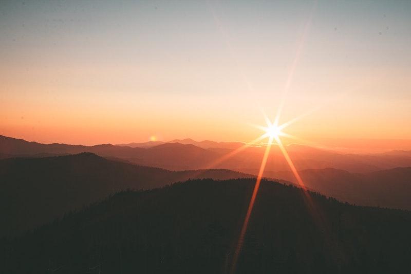 sun-over-hills
