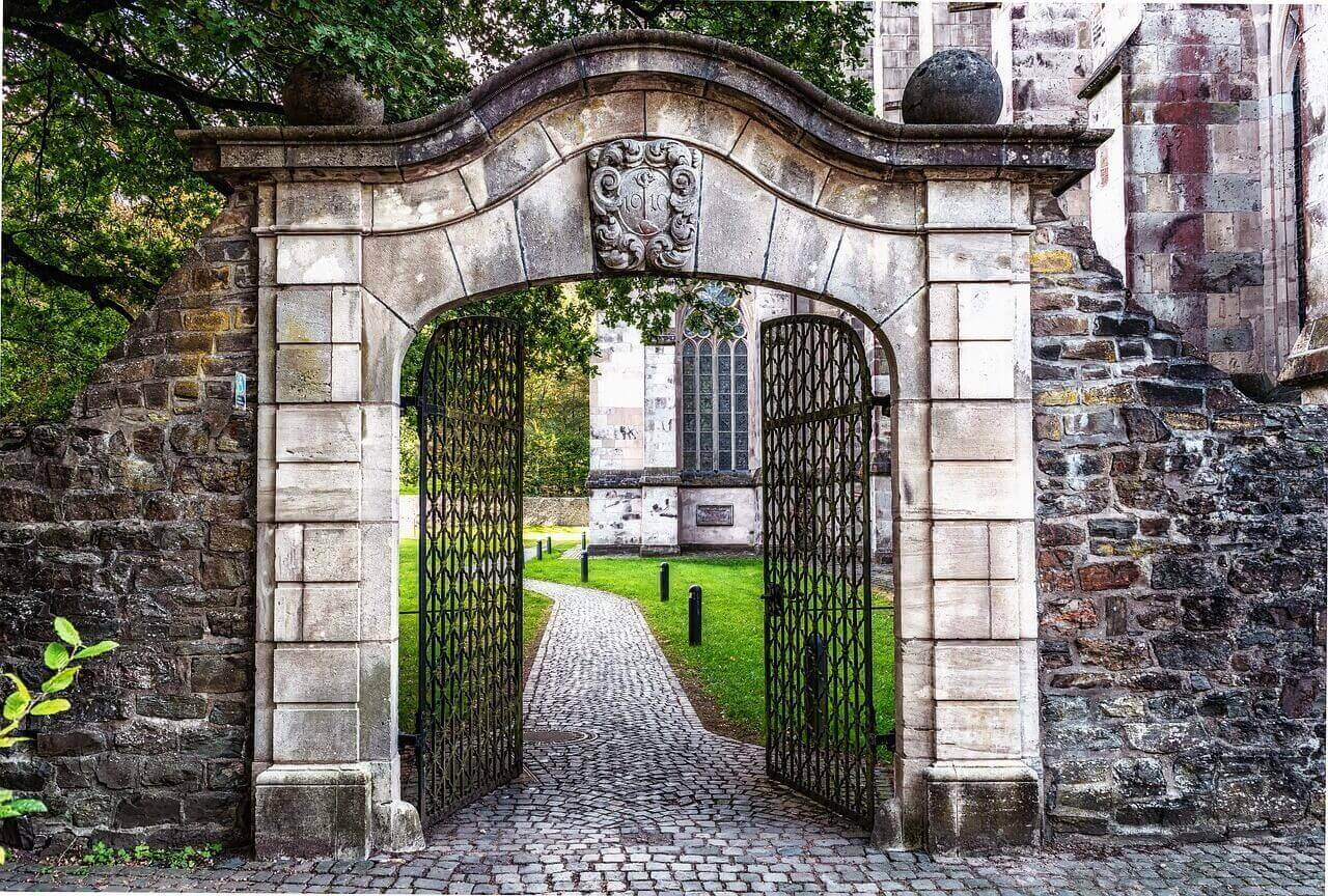 stone gate open to path