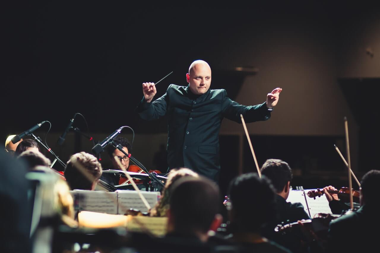 Conductor directing an orchestra