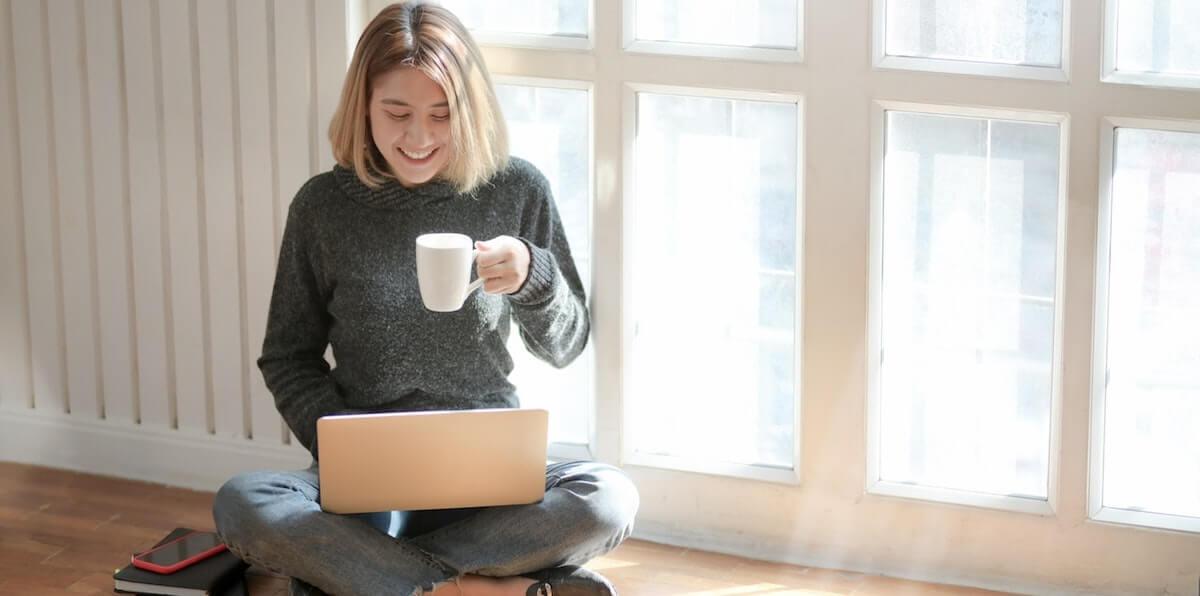 woman in gray sweater drinking coffee 3759089 2