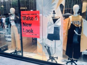 "a photo of fashion retailer b+ab's storefront in Shanghai with a sign that reads ""Make A New Look""."