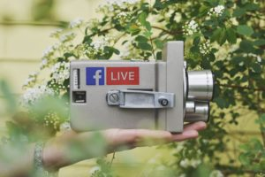 A vintage camera with a Facebook Live logo