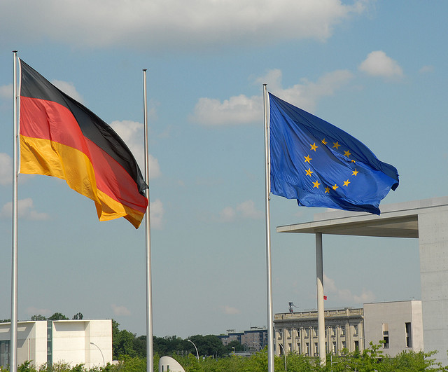 Photo of German and European flags in Berlin, from Flickr user Luigi Rosa
